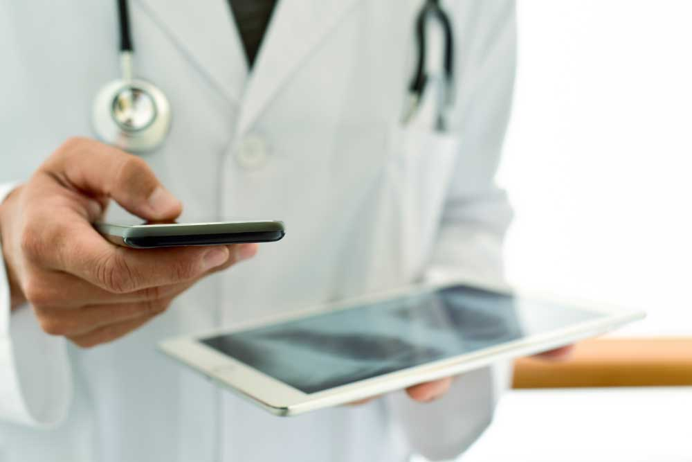 Doctor with phone on HIPAA Compliant Page
